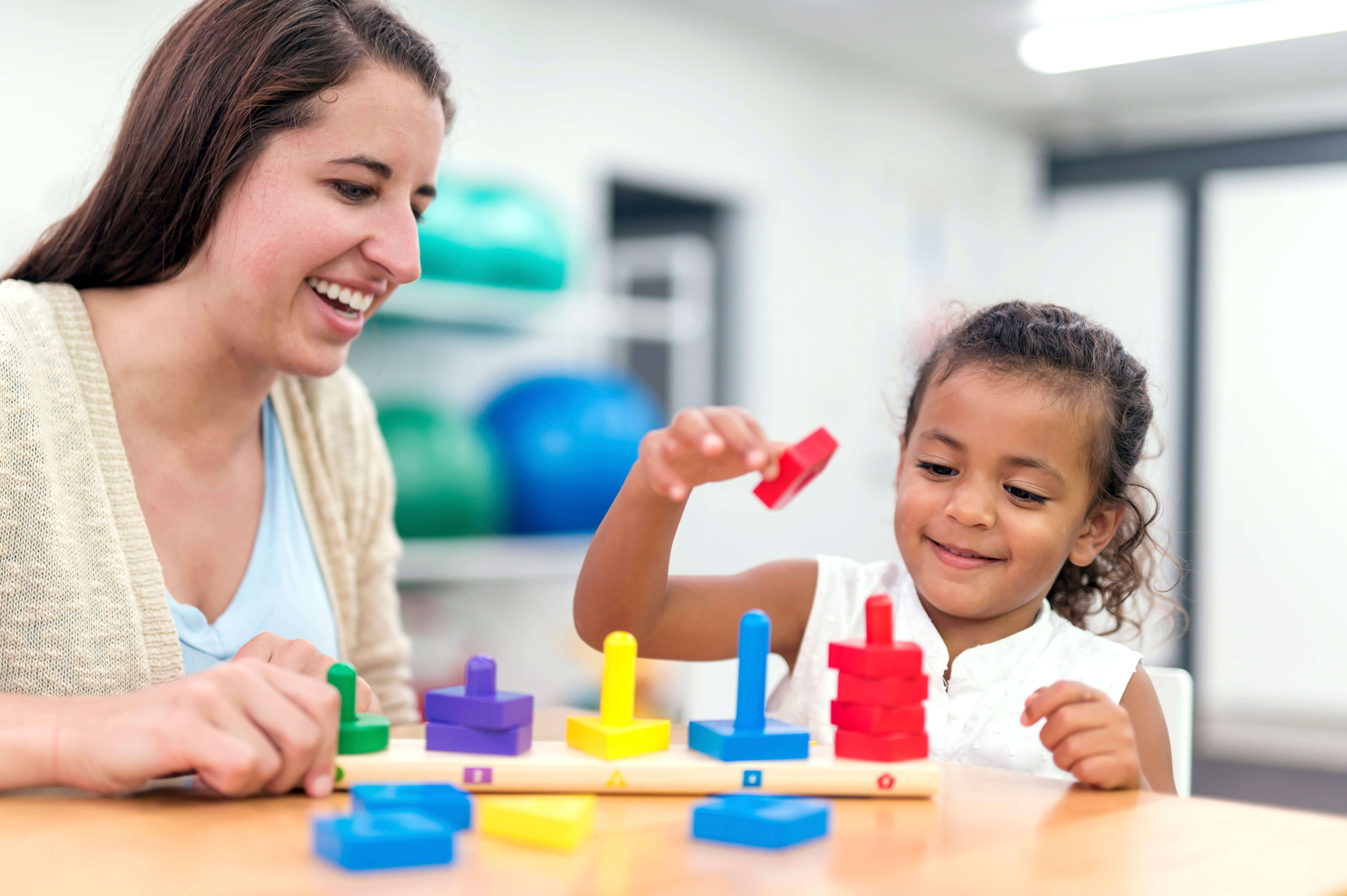 Young-ethnic-girl-doing-an-exercise-in-a-therapy-session - ABA