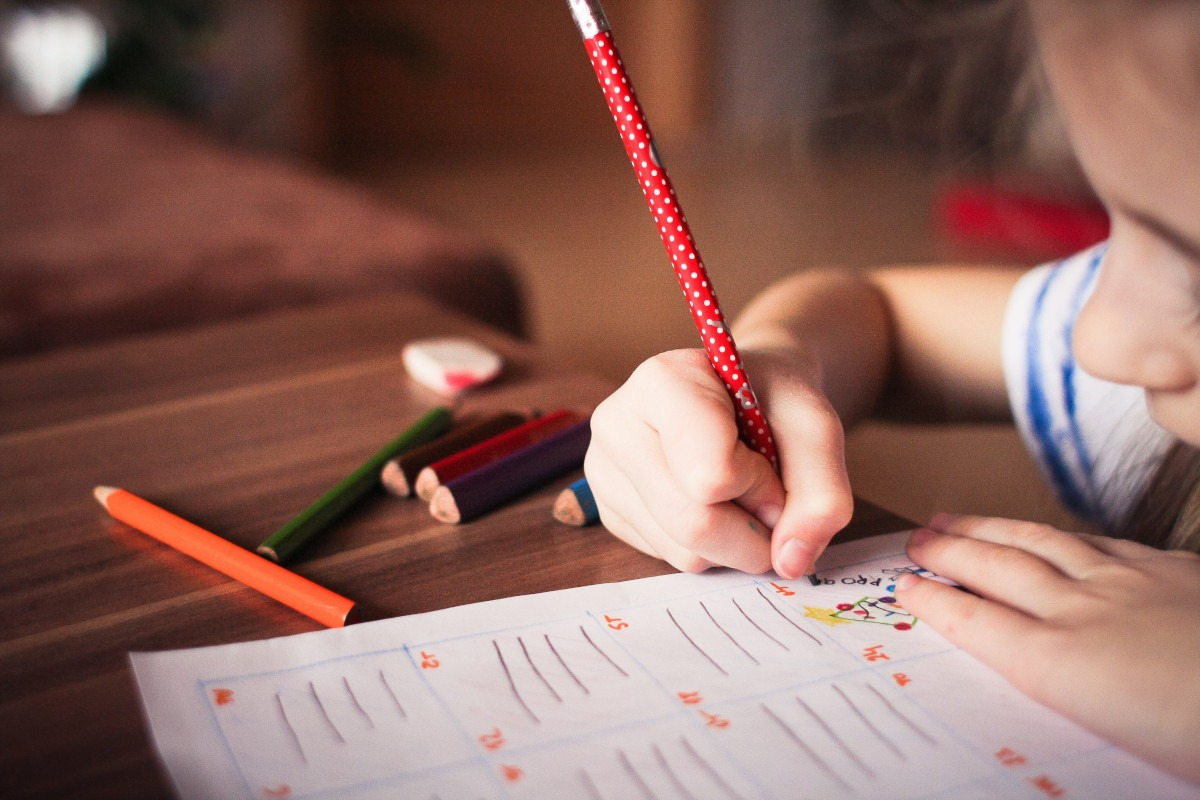 child with autism prepping for school