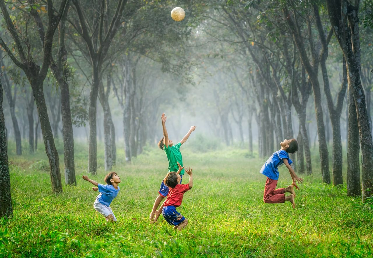 children playing outside with a ball